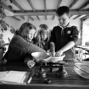 Siblings baking together at home in Gordon Scottish Borders family photography session