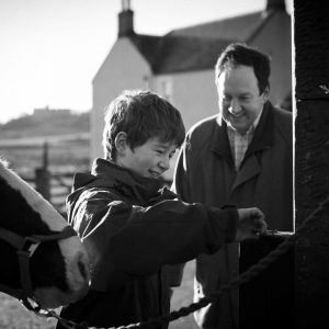 Father and son with horses at home in Duns Scottish Borders family photography session