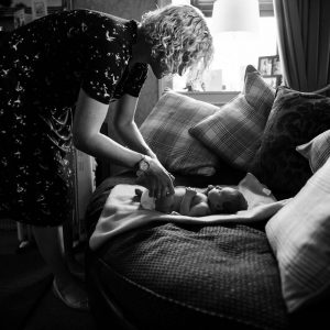 Mother changing newborn at home in Jedburgh Scottish Borders family photography session