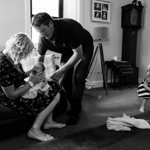 Mother and father with newborn baby crying in Jedburgh Scottish Borders family photography session