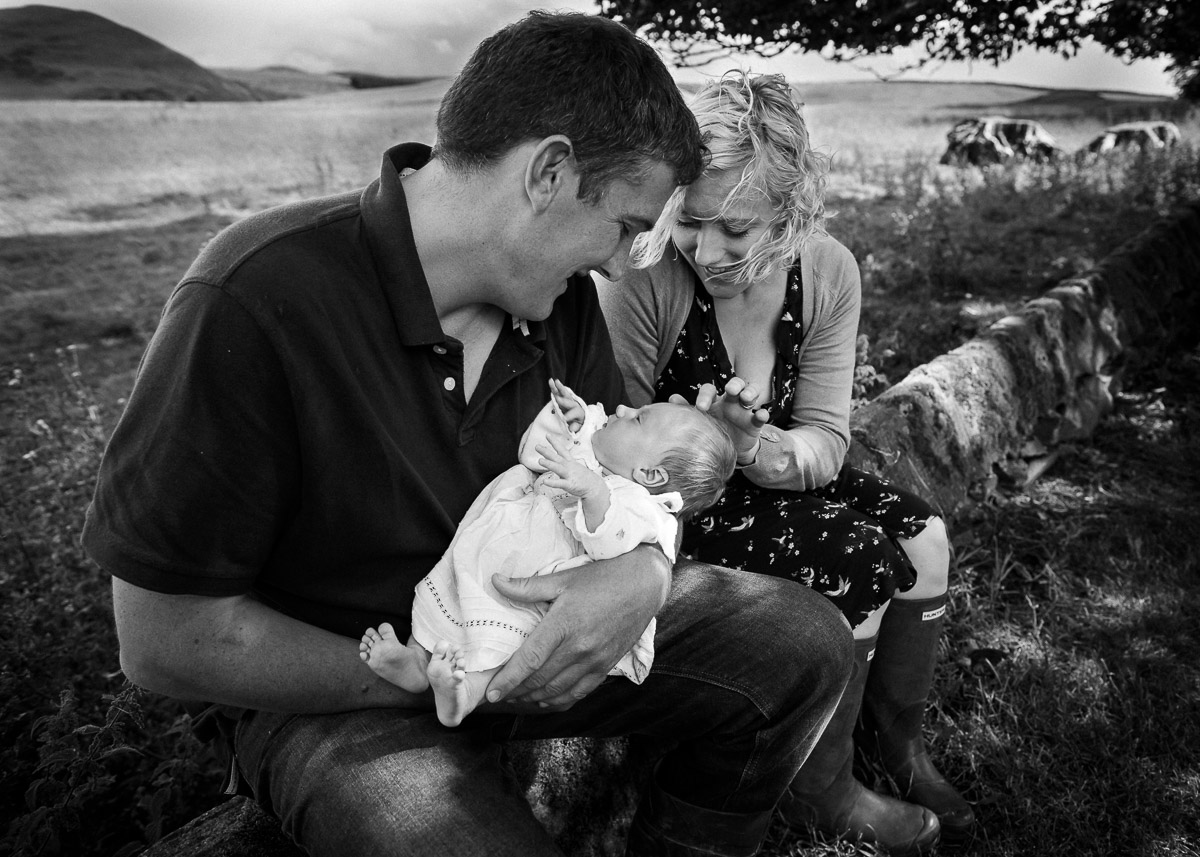 Mum and dad with newborn in Jedburgh Scottish Borders family photography session