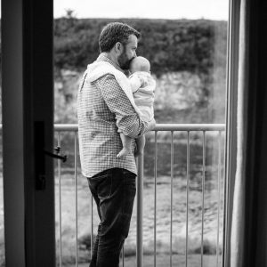 Father and baby son overlooking river in Roxburghe Kelso Scottish Borders family photography session