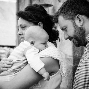 Mum and dad with baby outside in Roxburghe Kelso Scottish Borders family photography session