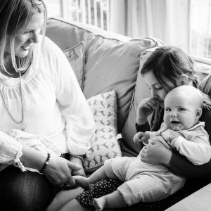 Girl with baby cousin on couch in Kelso Scottish Borders family photography session