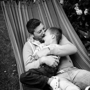 Dad and son cuddle in hammock in Kelso Scottish Borders family photography session