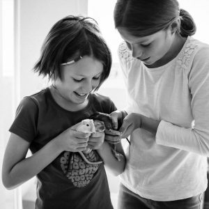 Sisters with pet gerbils at home in Kelso Scottish Borders family photography session