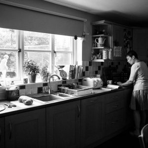 Mother cooking in kitchen in Kelso Scottish Borders family photography session