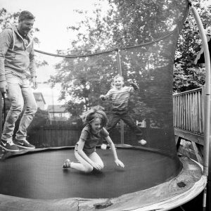 Family playing on trampoline in Kelso Scottish Borders family photography session