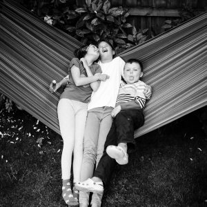 Brother and sisters laughing in hammock in Kelso Scottish Borders family photography session