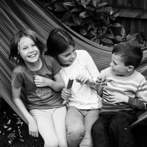 Siblings having fun in hammock in Kelso Scottish Borders family photography session