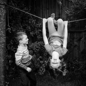 Brother and sister playing in garden in Kelso Scottish Borders family photography session