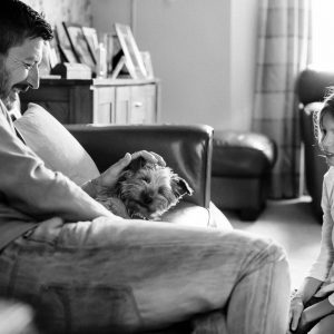 Father and daughter with dog on couch in Kelso Scottish Borders family photography session