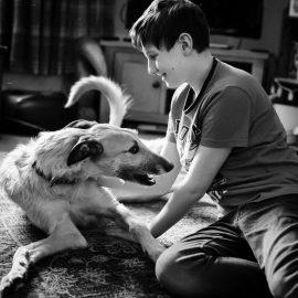 Teenage boy and dog in Berwick-upon-Tweed