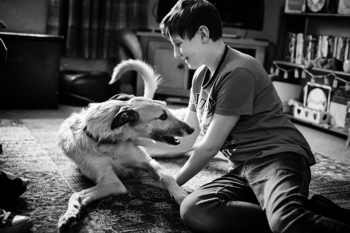 Teenage boy and dog in Berwick-upon-Tweed, Northumberland Family Photography